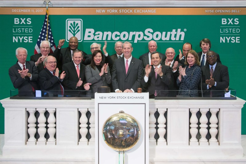 BancorpSouth Chairman and Chief Executive Officer Dan Rollins rings the NYSE opening bell on December 11, 2017, celebrating BancorpSouth's 20th anniversary on the NYSE. Pictured with Rollins are current and former BXS directors.