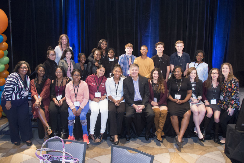 Rob Siegfried, the CEO and Founder of The Siegfried Group, poses with students following a Siegfried Youth Leadership Program event at the University of Delaware.