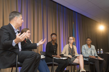 Rob Siegfried, the CEO and Founder of The Siegfried Group, speaks with a panel of students at Siegfried Youth Leadership Program event.