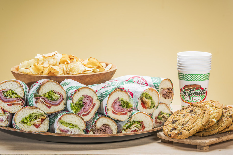 Make your taste buds jingle this holiday season with Jon Smith Subs' Plenti-Full Sub Platter. Receive a free tray of cookies with every sub platter purchase.