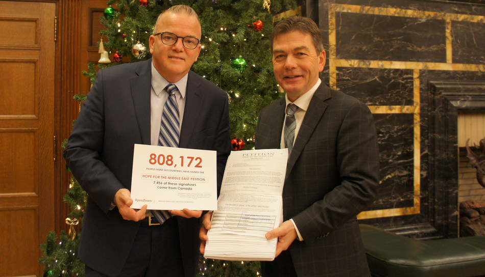The Hope for Middle East petition is presented to Mr. David Anderson in Centre Block on Parliament Hill by Gary Stagg, Executive Director, Open Doors Canada on December 11, 2017. Shortly after, the petition was presented by Mr. Anderson to the House of Commons, Government of Canada (CNW Group/Open Doors Canada)