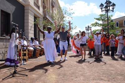 Puerto Rico announces it's officially Open for Tourism. The Island welcomed over 7,000 cruisers this past November 30, the first batch of passengers following Hurricanes Irma and Maria from cruises making a transit stop on the Island. Tourists are seen here dancing on the streets enjoying an extremely warm welcome from local performers. Puerto Rico is expecting 85,000 more passengers through January 31, 2018, proving once again Puerto Rico's comeback as a major vacation spot.