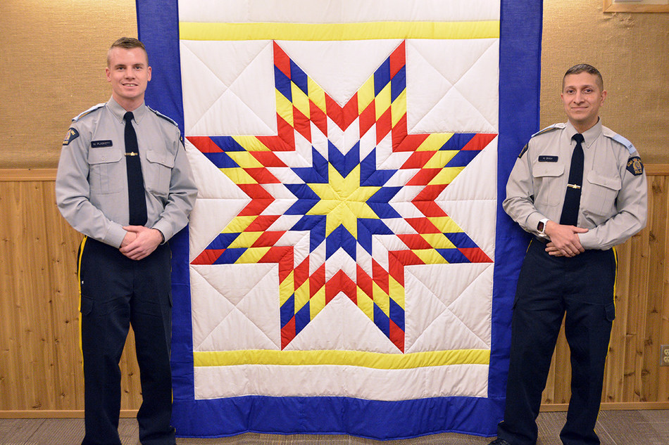 RCMP Cadets Matt Plaskett (left) and Habeeb Shah (right) of Troop 10, after completing the blanket exercise on Indigenous history as part of their training at the RCMP Academy. Credit: RCMP Academy, 2017. (CNW Group/Royal Canadian Mounted Police)