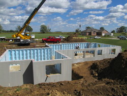 Installation of a precast concrete foundation from Superior Walls can help ward off heat loss and make the basement a more comfortable living area.
