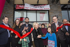 Salon owner Yasir Saeed, third from left, Fort Saskatchewan Mayor Gail Katchur, fourth from left, and COO Rob Goggins, second from right, cut the ribbon at the 150th Canadian Great Clips in Fort Saskatchewan, Alberta as attendees celebrate on Tuesday, December 12, 2017.  (Amber Bracken for CNW) (CNW Group/Great Clips, Inc.)