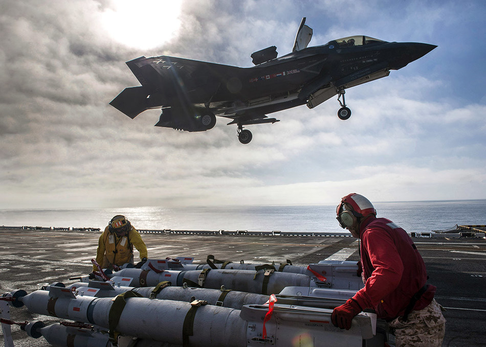 Nov 5, 2016: Sailors assigned to amphibious assault ship USS America (LHA 6) and F-35B Lightning II Marine Corps personnel prepared to equip the aircraft with 500-pound GBU-12 Paveway™ II Plus Laser Guided Bombs during F-35B flight test operations in the Pacific Ocean. U.S. Navy photo by Petty Officer 3rd Class Kyle Goldberg/Released.