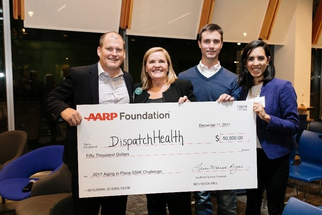 AARP Foundation President Lisa Marsh Ryerson and Rock Health CEO and Managing Director Bill Evans present check to DispatchHealth, the winners of the 2017 Aging in Place $50K Challenge. Photographer Credit: Kara Brodgesell.
