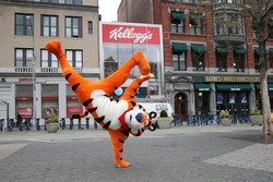 Tony the Tiger® celebrates the new Union Square Kellogg's® NYC Café. The café offers exciting new ways to explore the unexpected flavors of cereal – all day, every day. Permanently open Dec. 14th. Credit: Mark Von Holden/AP Images for Kellogg's