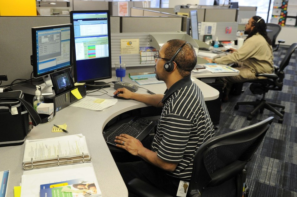 DTE Energy customer service representatives answer calls from customers.