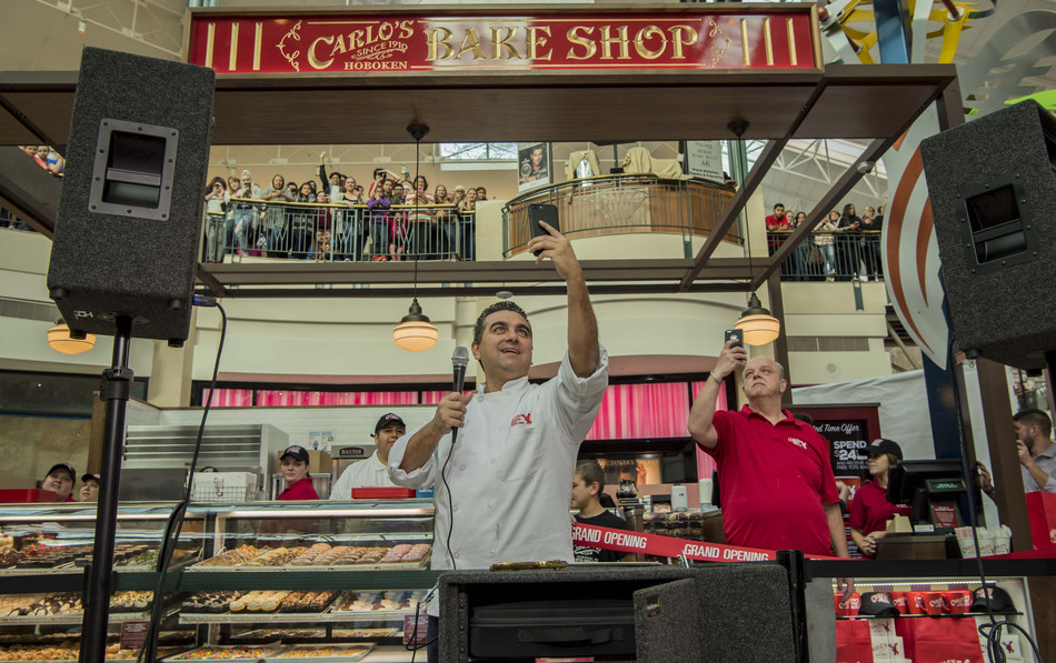 """Buddy """"Cake Boss"""" Valastro and Mauro Castano of Carlo's Bakery at the recent grand opening of the bakery's kiosk at The Woodlands Mall in Woodlands, Texas."""
