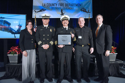 Jeanette Eaton, regional sales director for North America; Thomas Ewald, deputy chief of Los Angeles Fire Department's Air and Wildland Division; Vince Pena, deputy chief at Los Angeles County Fire Department; Dennis Blumenthal, chief of helicopter maintenance for the  Los Angeles County Fire Department; and Bill Gostic, vice president of Sikorsky, present a plaque to the Fire Chiefs commemorating the delivery of the first S-70i Black Hawks in the U.S. and continuing the Firehawk legacy with the Los Angeles County Fire Department.