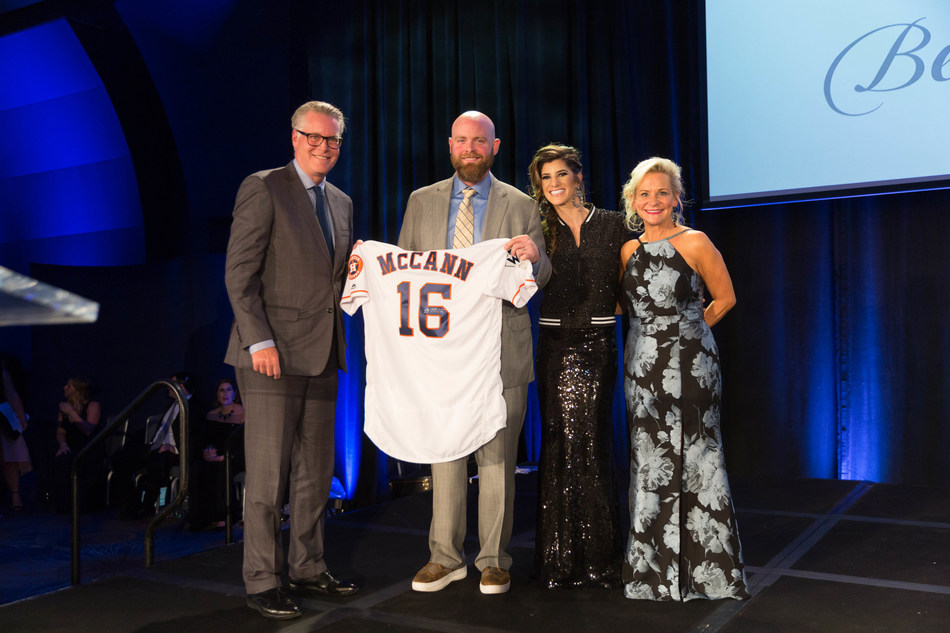 (Left - Right) Ed Bastian, CEO of Delta Air Lines, Rally Spokespeople Brian and Ashley McCann, and Dean Crowe, founder and CEO of Rally Foundation, present Delta with a Brian McCann Houston Astros World Series Championship jersey to commemorate the company's title sponsorship of the Delta Double Play Benefit Bash on Nov. 10, 2017.
