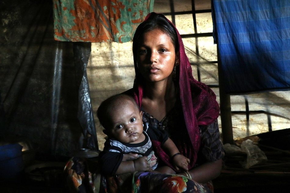 Jamira, 26, lives in Bangladesh's refugee settlements with her two children, who have both become ill since fleeing Myanmar. Courtesy World Vision (CNW Group/World Vision Canada)
