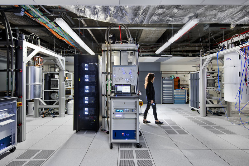 An IBM quantum scientist walks across the IBM Q computation center at the TJ Watson Research Center in Yorktown Heights, NY. The new center houses IBM's most advanced quantum computers, accessed via IBM Cloud by IBM Q Network clients. The clients from Fortune 500 companies, academic institutions, and national research labs, hailing from across the globe, are collaborating with IBM to advance quantum computing, exploring practical applications for business and science. (Photo by Connie Zhou)