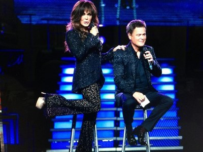 Donny and Marie performing at The Hollywood Christmas Parade, a two-hour primetime special tomorrow – Friday, December 15, 2017 -- on The CW at 8:00 p.m. ET / PT (7:00 p.m. CT).