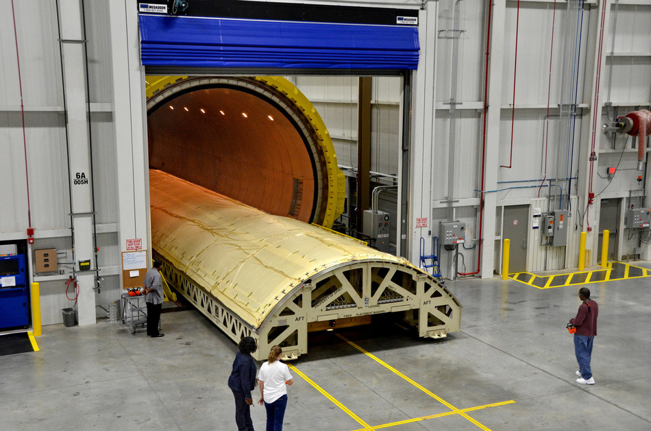 Spirit AeroSystems uses some of the world's largest autoclaves to support the company's composite fuselage business. The new intelligent heated tool technology can cure composite parts 40 percent faster and at half the cost without using an autoclave.