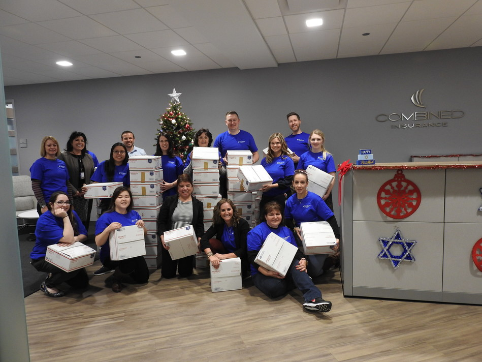 Combined Insurance employees assembled 100 'Sweet Home Chicago'  care packages for deployed Illinois service members in partnership with the USO of Illinois.