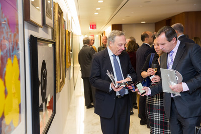 Dr. Charles R. Marmar, Dr. John Golfinos, and Dr. Koto Ishida browse artwork from Andy Warhol, Norman Rockwell, and David Hockney, among others.