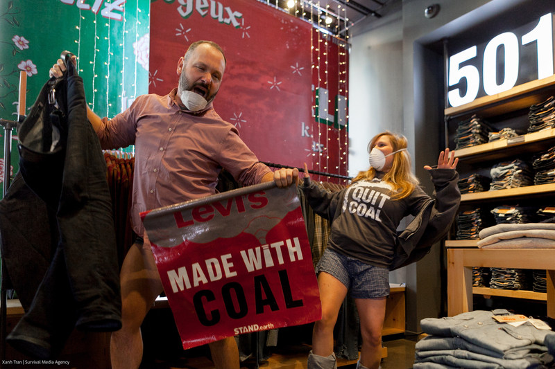 """Climate activists with Stand.earth's """"Too Dirty to Wear"""" campaign take off their jeans and dance at Levi's flagship store in San Francisco, as part of a flash mob to protest Levi's climate pollution impacts and call on the company to transition the factories that supply its jeans away from coal and toward renewable energy. Photo and video by Survival Media Agency"""