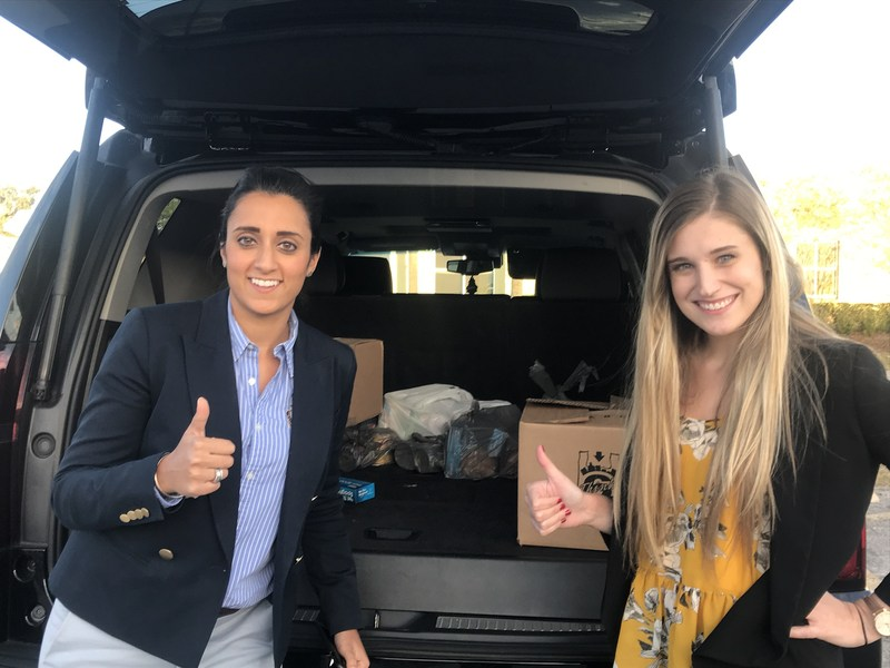 The team at Prestige Business Solutions delivered food drive gifts to United Against Poverty Orlando.