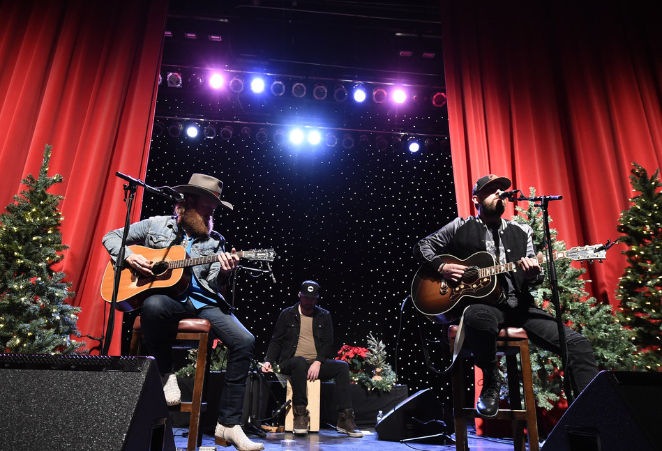 Musician John Osborne, left, and musician TJ Osborne, right, of the duo Brothers Osborne perform at a private concert and dinner hosted by Verizon Telematics for truck drivers on Thursday, Dec. 14, 2017 at Whiskey Pete's Showroom in Primm, Nev. (Photo by Dan Steinberg/Invision for Verizon Telematics/AP Images)