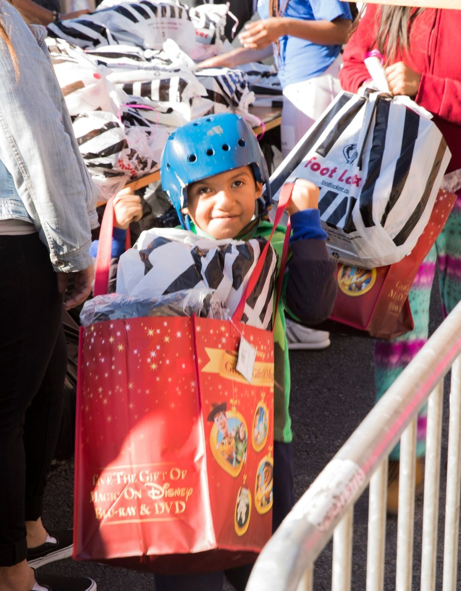 10,000 homeless and poor kids get 50,000 new toys at the Fred Jordan Mission Christmas Toy Party.