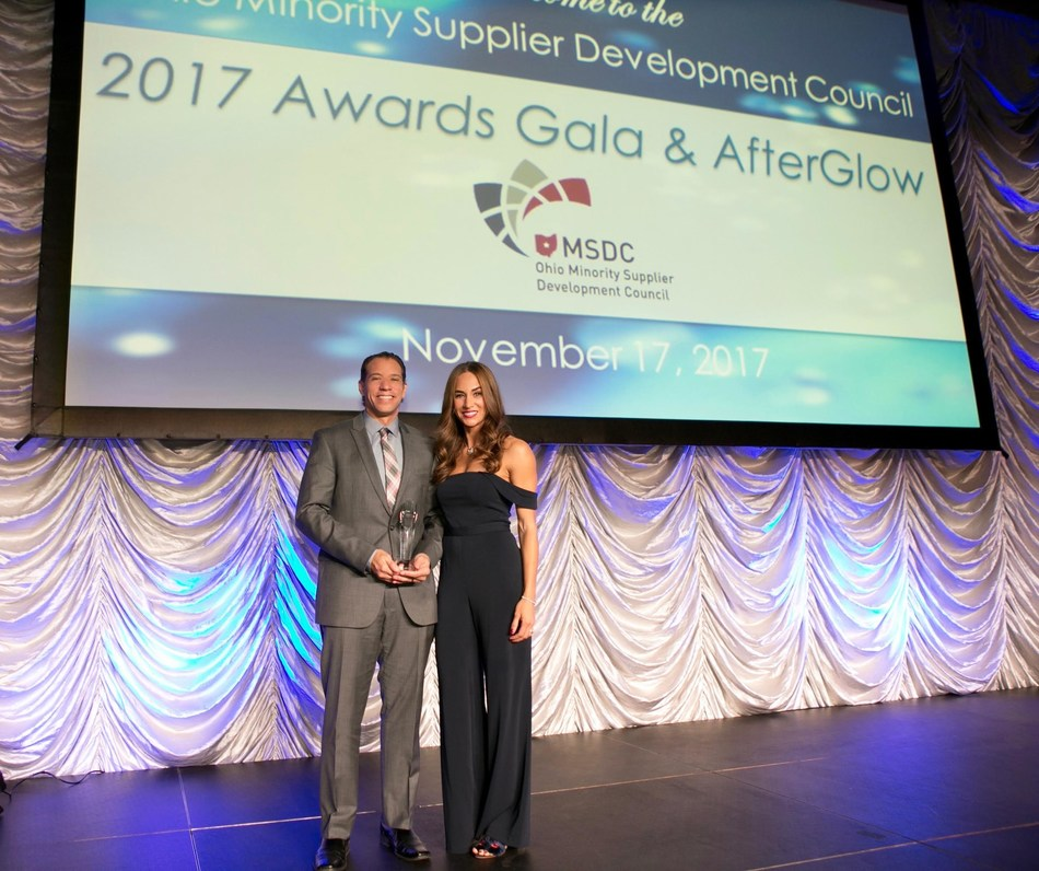 E.E. Ward Moving & Storage co-owners Dominique and Brian Brooks accept the Minority Business Enterprise (MBE) Supplier of the Year Award (Class II) at the Ohio Minority Supplier Development Council (OMSDC) Annual Awards Gala on November 17.