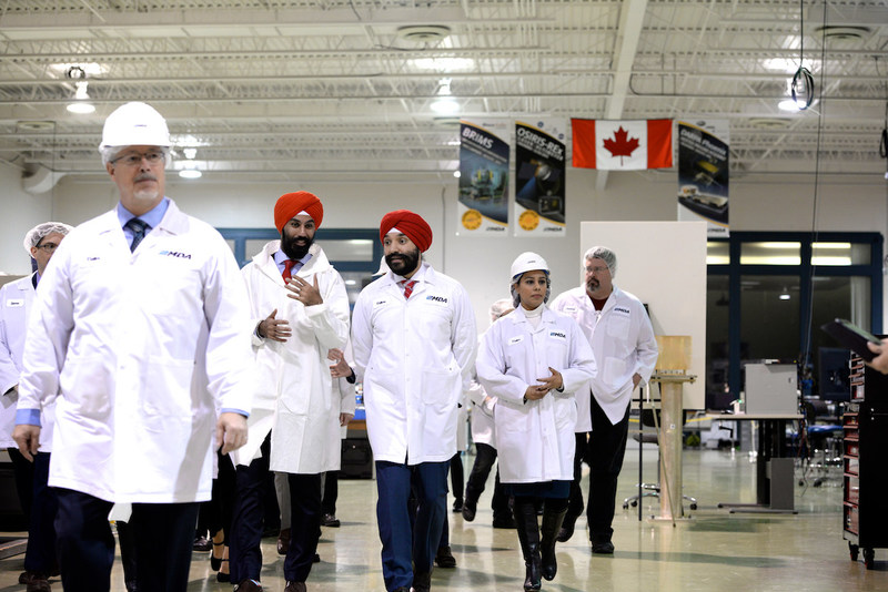 The Honourable Navdeep Bains, Minister of Innovation, Science and Economic Development visiting MDA facilities in Brampton, Ontario, with other members of Parliament as well as Canadensys Aerospace and Western University representatives. (CNW Group/Canadian Space Agency)