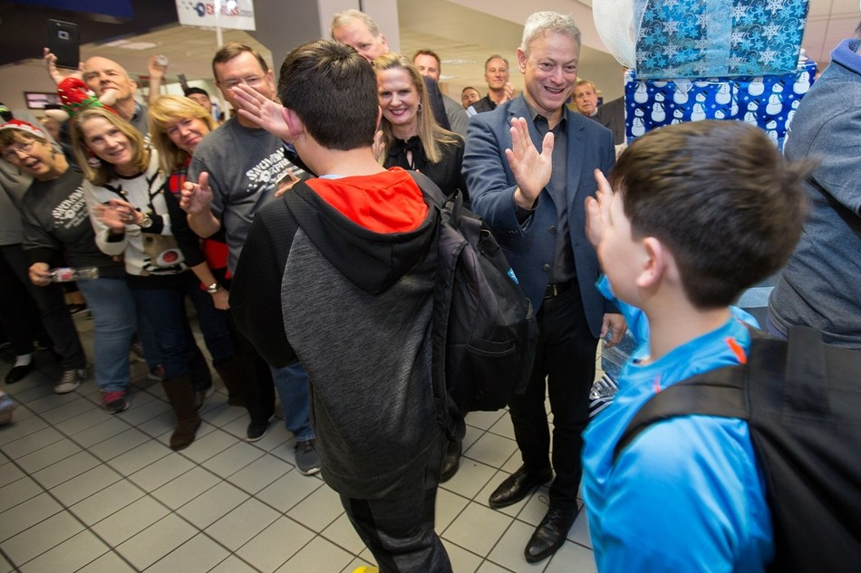 Gary Sinise greets Gold Star families at Dallas International Airport as they arrive for the eleventh annual Snowball Express which will officially become a program of the Gary Sinise Foundation in 2018.