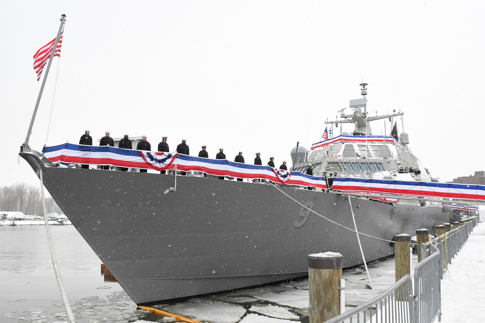 Sailors assigned to the Freedom-variant littoral combat ship USS Little Rock (LCS 9) man the ship's rails during the commissioning ceremony on the Buffalo River on Dec. 16. Photo credit: Lockheed Martin.