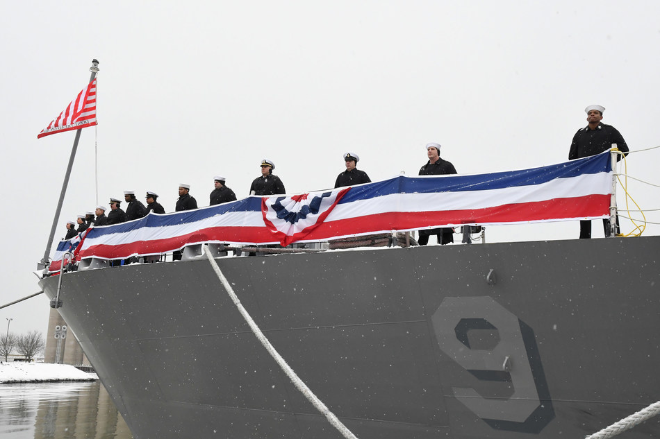 Sailors assigned to the Freedom-variant littoral combat ship USS Little Rock (LCS 9) man the rails as snowflakes fell during the ship's commissioning ceremony on the Buffalo River on Dec. 16. Photo credit: Lockheed Martin.