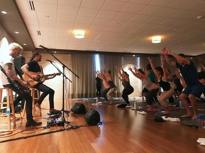 Musician, filmmaker, yogi and humanitarian Michael Franti performs during a special yoga class at the new Life Time Athletic in Charlotte, NC on Dec. 16, 2017.