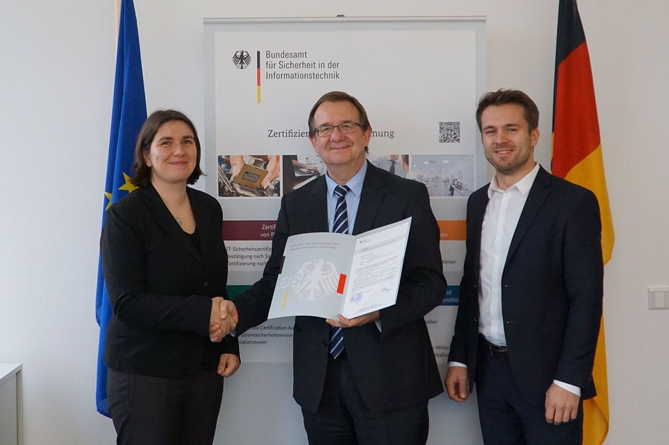 "Joachim Weber (center), Head of Certification and Standardization at the German Federal Office for Information Security (BSI), hands over the certificate for the ""ePassport MRTDAPI"" software to Manuela Tiedemann and Marco Zamponi of DERMALOG. Photo credit: Bundesamt für Sicherheit in der Informationstechnik (BSI), Abdelilah Ammou (PRNewsfoto/DERMALOG Identification Systems)"