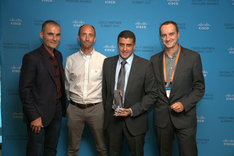 Nourdine Bihmane, COO for Atos Infrastructure Data Management; and Andy Fleck, Head of Multi-Cloud Management for Engage ESM; accepts award from Ken Trombetta, Cisco Vice President, Global and Strategic Partners; and Christophe Labro, Cisco Client Director Atos