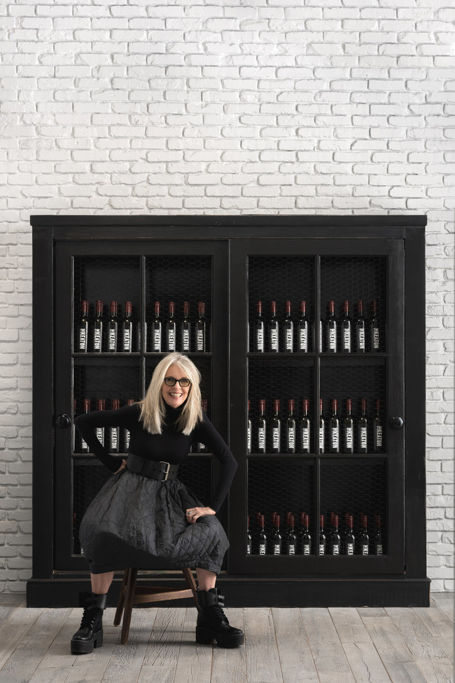 Diane in front of bookcase filled with Keaton Wine (credit: Jesse Stone)