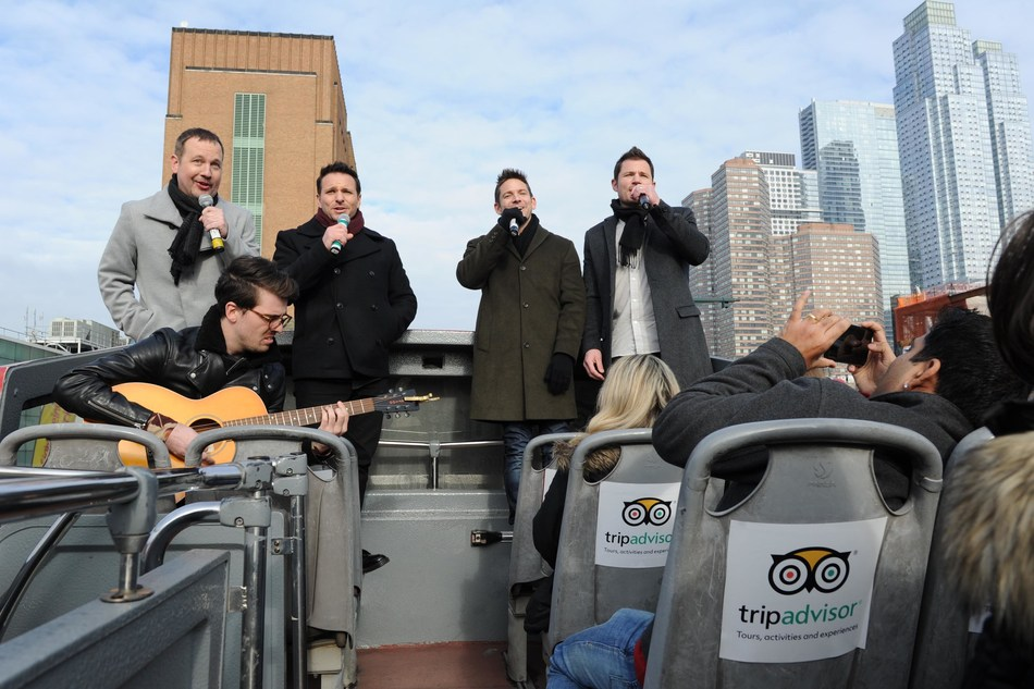 TripAdvisor surprised unsuspecting tour-goers aboard its NYC bus tour with a special holiday serenade by 98 Degrees