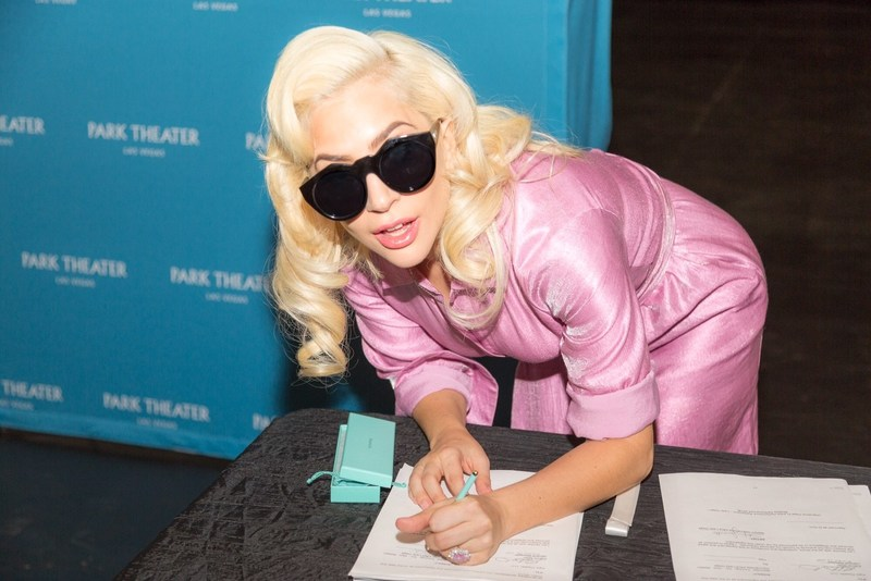 Lady Gaga signs the contract, finalizing her two-year engagement at Park MGM beginning in December 2018. Credit: Alex Dolan