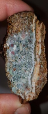 Polymict conglomerate with quartz-pyrite veinlet (CNW Group/Northern Shield Resources Inc.)