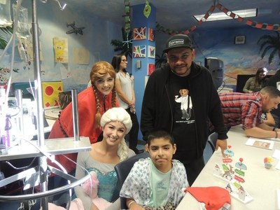 Power 106 personality, J Cruz, was joined by Frozen characters, Elsa and Ana, as they brought the pediatric playroom at Miller Children's & Women's to life with music.
