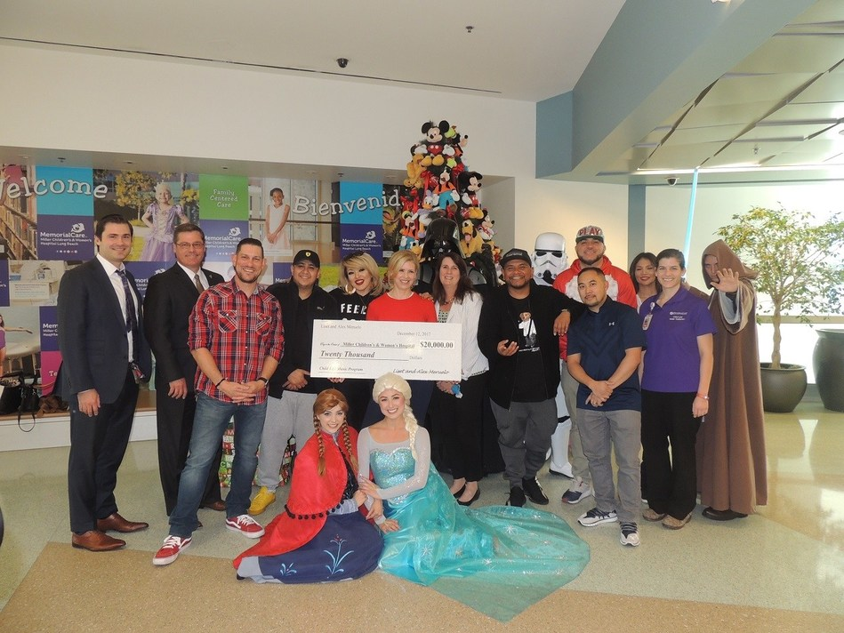 Executives from MemorialCare Miller Children's & Women's Hospital Long Beach accepted a $20,000 donation from Liset and Alex Meruelo, of the Meruelo group, to support the Music Therapy Program.