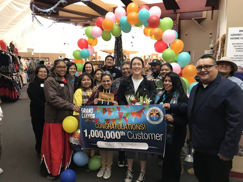 Grand Canyon West celebrates surpassing 1 million annual visitors for the third consecutive year by honoring guests Abbi Reynolds and Caitlin Wiggins of Apex, NC.