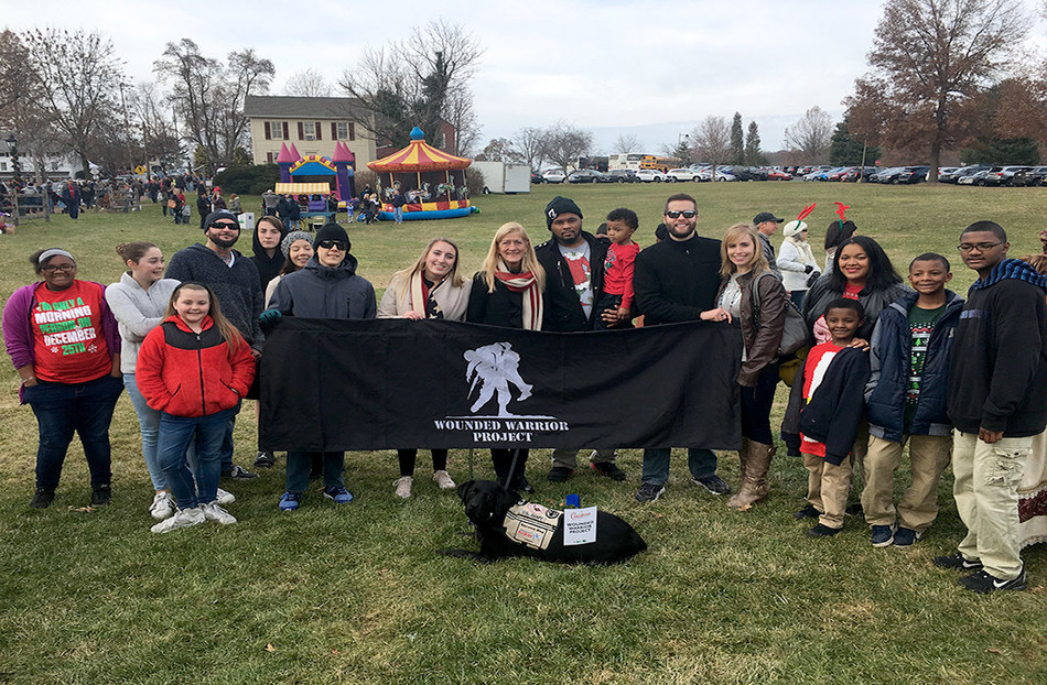Warriors, families, and friends gather at Peddler's Village in New Hope, Pa. for a Christmas parade and festivities.