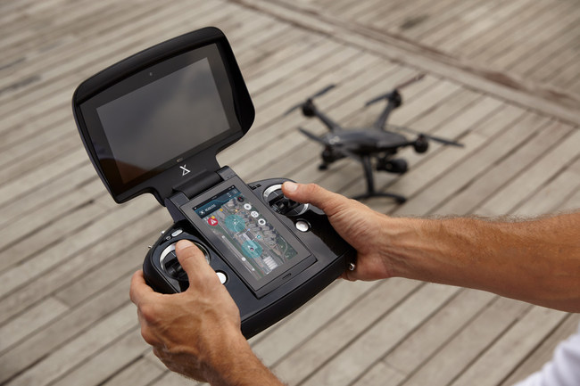 The carbon fiber monocoque chassis of the XDynamics Evolve drone strengthens structural stability and improves flight dynamics. Its remote controller is a smart pilot system which embeds a 7-inch viewfinder, 5-inch touch control panel, processing hardware, and software in an all-in-one package.