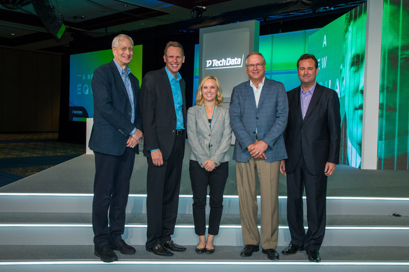 Sharp's Mehryn Corrigan (center) joins Tech Data's executive team on stage for the Tech Data Marketing and Sales Innovator of the Year Award.