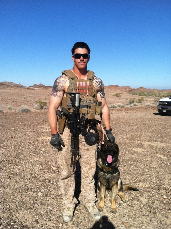 Marine Sgt. Joshua Ashley (22-years-old) stands with his military dog companion, Sirius, named after the brightest star in the constellations. Ashley was slain on a mission in Afghanistan. His dog survived to do one more tour of duty. It was Ashley's wish that his mother, Tammie, received Sirius after his tour of duty ended.