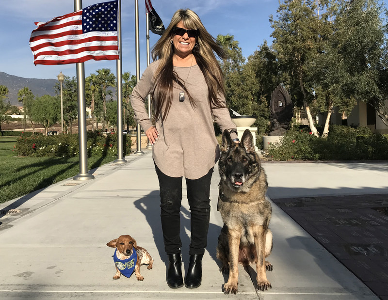 Rancho Cucamonga resident Tammie Ashley, mother of slain Marine Sgt. Joshua Ashley, proudly stands with Sirius, the dog her son wanted given to her after the dog's his final tour of duty. Also pictured is Certified Therapy Dog, Coppertone, who is also a champion surf pup!