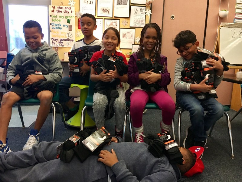 Students at John Muir Elementary School with Sof Sole socks
