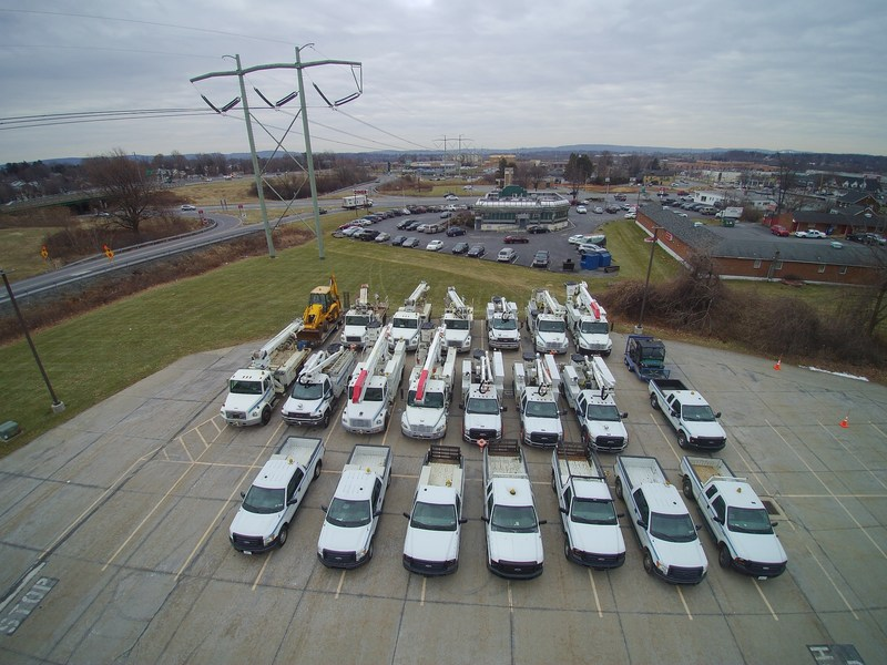 PPL Electric Utilities service vehicles are gathered near Allentown, Pa., in preparation for travel to Puerto Rico to provide storm restoration assistance.