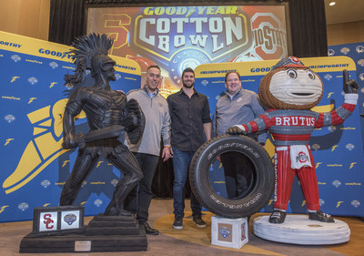 Ahead of the 82nd Cotton Bowl Classic,  tire sculptures of the University of Southern California mascot, Tommy Trojan, and The Ohio State University mascot, Brutus are unveiled by Goodyear Director of North America Marketing Seth Klugherz, Cotton Bowl Chief Marketing Officer Michael Konradi and tire artist Blake McFarland.