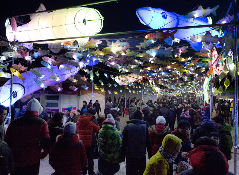 This 2017 file photo shows a visitor watching Inje Ice Festival in Inje